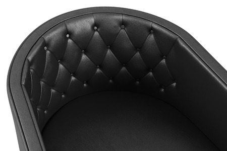 Closeup of black leather armchair isolated on white background.