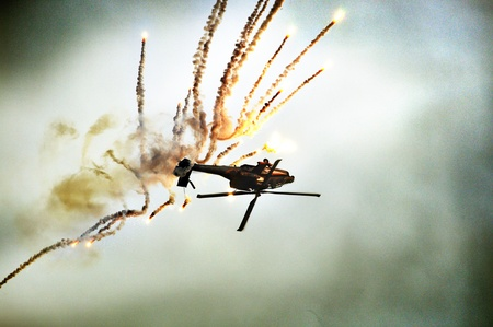 rescue helicopter: an helicopter falling down the sky with explosion Stock Photo
