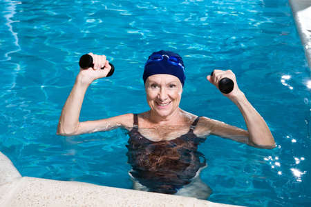 healthy seniors: Senior woman in a swimming pool Stock Photo