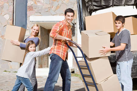 family moving house: Family moving into a new house Stock Photo