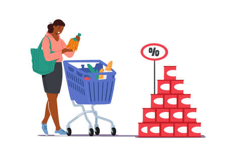 Customer in Grocery or Supermarket with Goods in Shopping Trolley Holding Bunch of Carrot in Hand. Woman Visiting Store