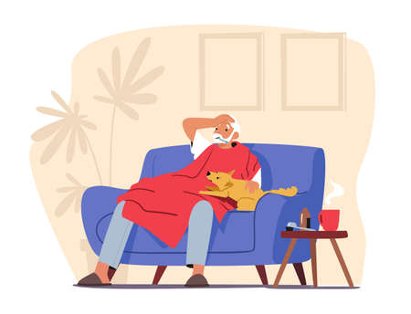Elderly Man with Thermometer in Mouth Sitting on Sofa Covered with Blanket. Ild man Measuring Temperature