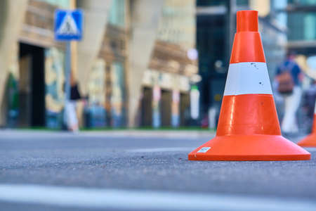 traffic cones stand on the asphalt
