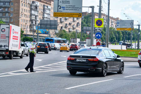 Moscow July 2020. Traffic police stop car on highway Foto de archivo
