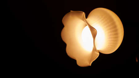 Lamp night light in a dark background. Vintage effect style picture. Minimal concept.
