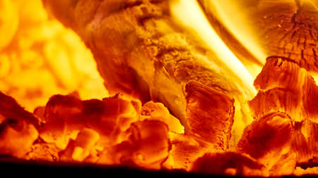 Close up shot of burning firewood in the fireplace. Stock Photo