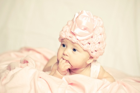 warm cloth: baby girl in a pink hat Stock Photo