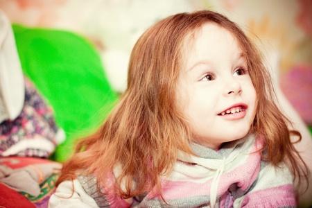 portrait of a happy little girl  indoor Stock Photo