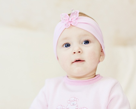 bright closeup portrait of adorable baby girl photo