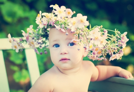 dreaming girl in the big flower garland Stock Photo