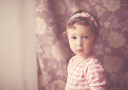 portrait of a baby girl in vintage style photo