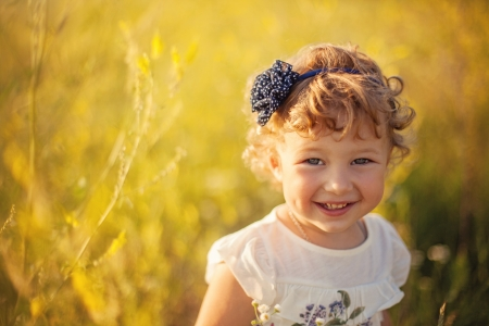 Smiling little girl on the field