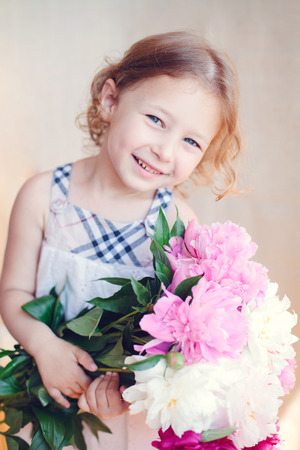 blithe: portrait of adorable little girl with flowers
