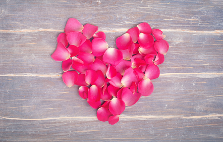 Heart fromm flowers on the wooden background 스톡 콘텐츠