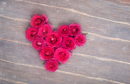 pink flowers: Heart fromm flowers on the wooden background Stock Photo