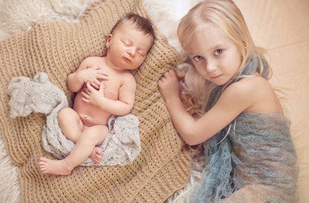 nude little girls: healthy newborn baby one week old sleeping near his older sister