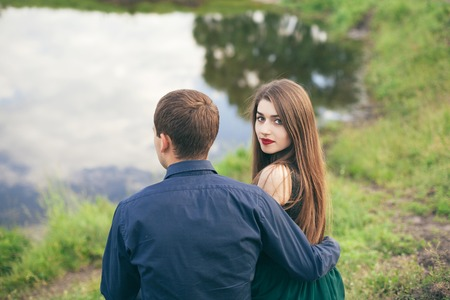 Beautiful young loving couple enjoing good weather in summer
