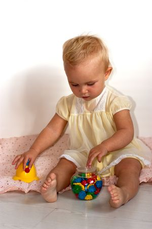 Cute baby playing on white background photo