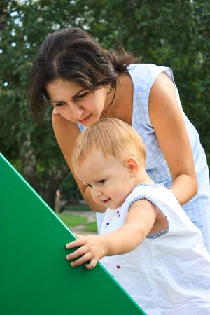 Little baby girl with mother in playground outdoor Stock Photo - 8201977