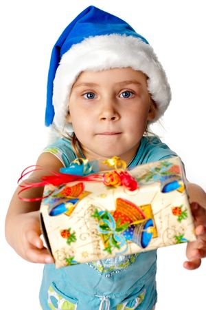 Girl in Santasblue hat giving out s present isolated on white photo