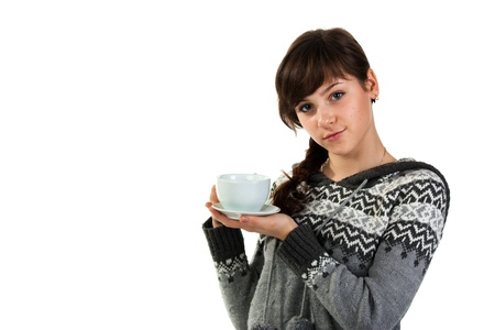 Beautiful girl holding a cup of tea isolated on white photo