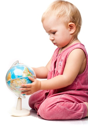 Beautiful baby holding a globe isolated on white