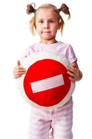 Child holding a pillow with stop sign isolated on white photo