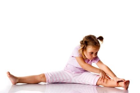 Beautiful girl exercising, stretching isolated on white