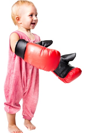 Beautiful babyl in boxing gloves punching isolated on white