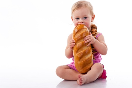 Baby holding a loaf of bread in roll beads isolated on white photo