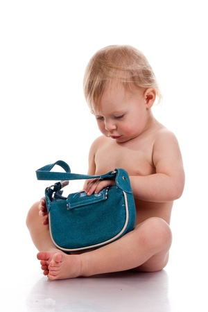 Baby looking into a small bag curious isolated on white
