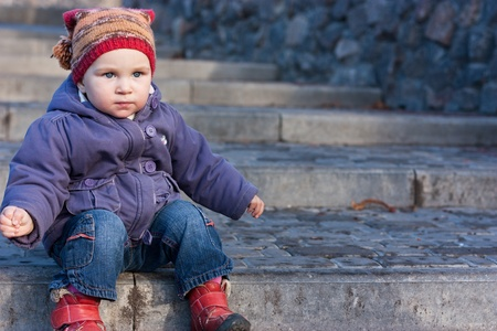 Beautiful baby sitting on stairs outdoor Stock Photo - 8565142