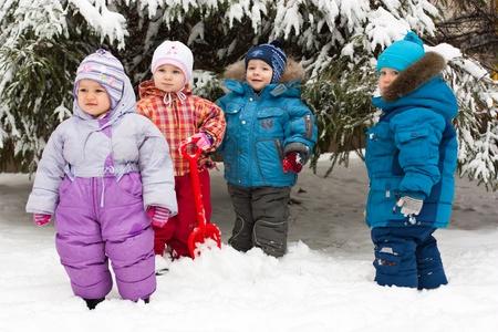 Children playing in snow outdoor in winter