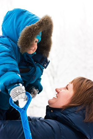 Mother and son outdoor in winter  photo