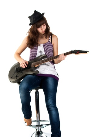 Beautiful girl playing the guitar isolated on white photo