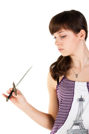 Beautiful girl with a knife pensive isolated on white photo