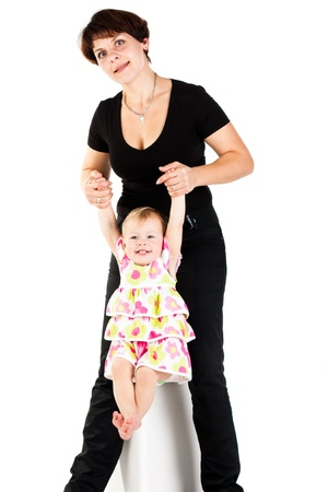 Mother and daughter isolated on white photo