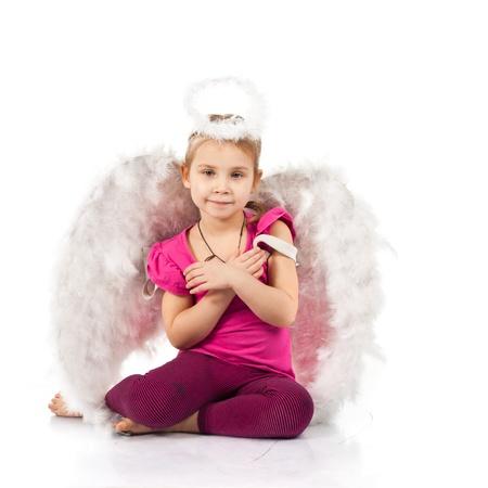 nimbus: Beautiful girl in angel wings and nimbus isolated