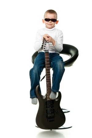 Cute little boy holding a guitar isolated on white Stock Photo - 9124789