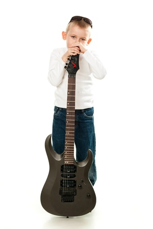 Cute little boy holding a guitar isolated on white Stock Photo - 9124782