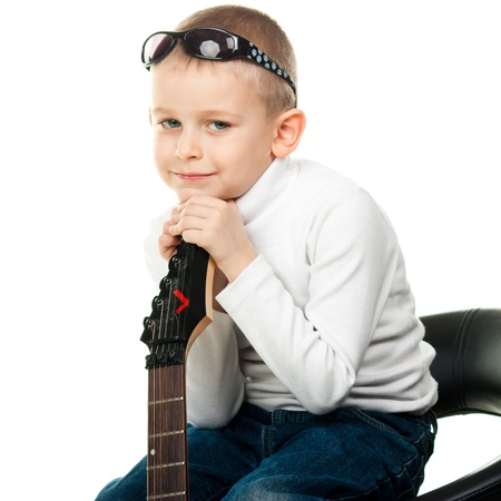Cute little boy holding a guitar isolated on white Stock Photo - 9124786