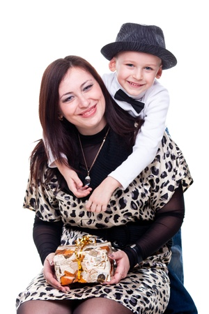 Happy mother with son smiling isolated on white photo