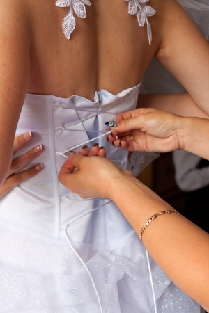 Wedding gown being tied up at back Stock Photo - 10222142