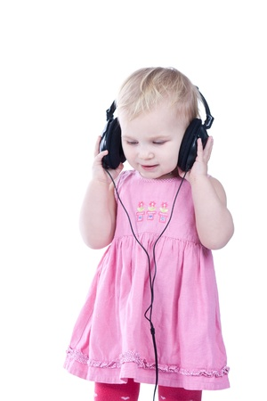 Baby with headphones, isolated on a white background  photo