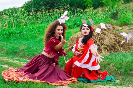 Two beautiful gypsy girls throwing cars outdoor Stock Photo - 10399282