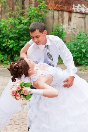 Bride and groom dancing photo