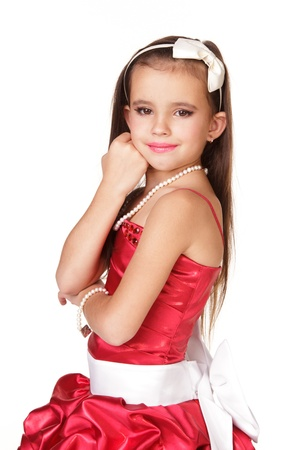 red evening: Beautiful little girl in red evening dress on white background