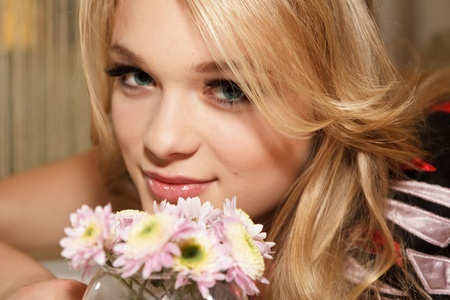 Portrait of a beautiful girl with flowers in a cafe interior photo
