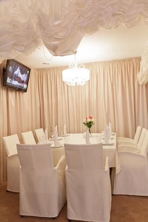 Modern cafe interior, table photo