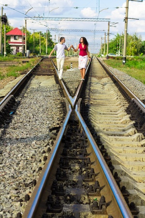 Beautiful happy love couple on rails outdoor  Stock Photo